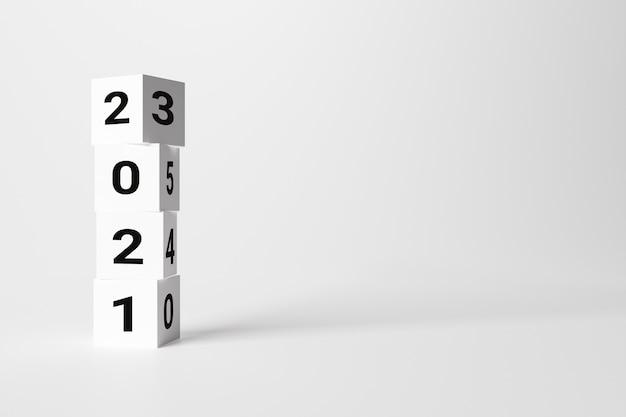 白い背景の白い立方体2021、コピースペースに書かれたクリスマスのコンセプト