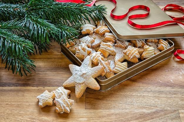 Christmas cookies on a box and christmas tree