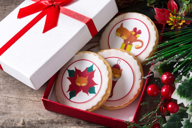 Christmas cookies decorated with christmas graphics in to gift box
