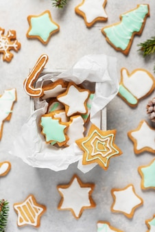 Christmas cookies decorated with iced colored sugar on the light background. pattern concept