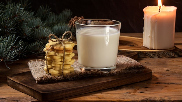 Christmas cookies and milk for santa clause on wood