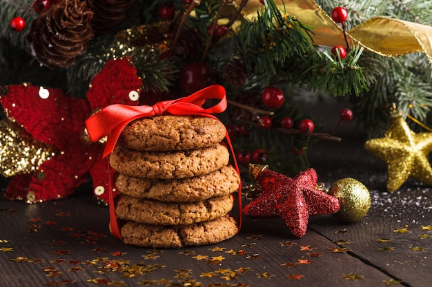 Christmas cookies on the table with red ribbon