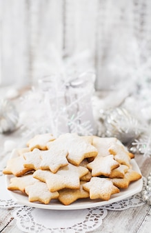 Christmas cookies and tinsel on a wooden table