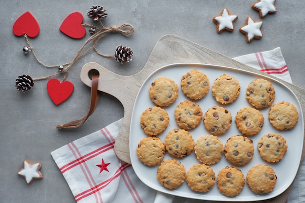 Christmas cookies with anise and cinnamon spices and winter decorations, top view