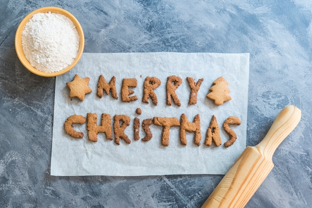 Christmas cookies with the letters merry christmas 2021