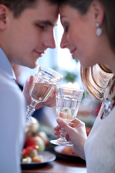 Christmas couple drinking champagne