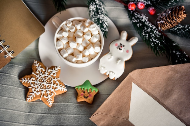 Christmas cup of cocoa with marshmallows, delicious new year's cookies on w bed. winter concept. cozy sweet home. nobody indoor.