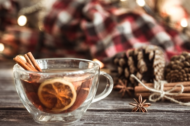 Christmas cup with cinnamon and lemon