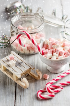 Christmas cup with small marshmallows and candy canes