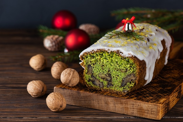 Christmas cupcake with spinach walnut and lemon with a spruce branch and christmas balls