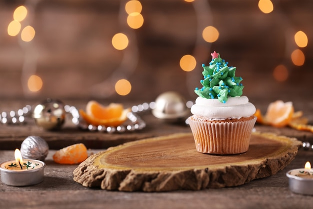Christmas cupcake on wooden stand