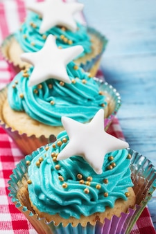 Christmas cupcakes with a star on the wooden table
