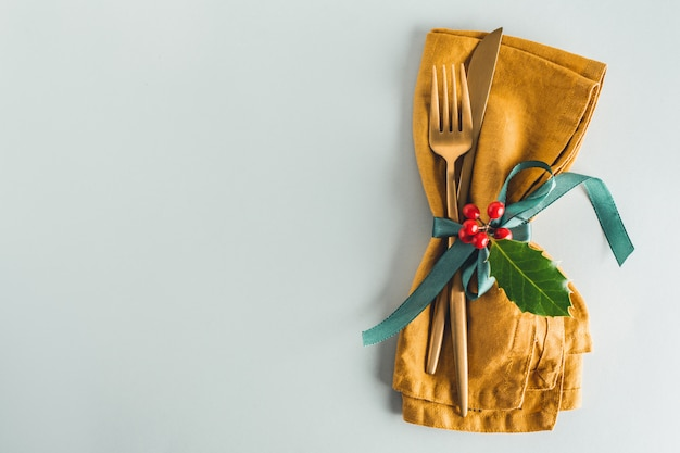 Christmas cutlery with napkin on plate