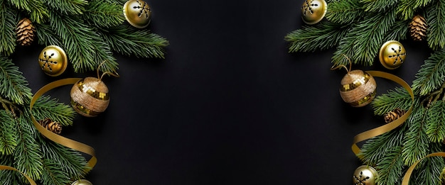Christmas deco with fir and baubles on dark background. flat lay. christmas concept. horizontal