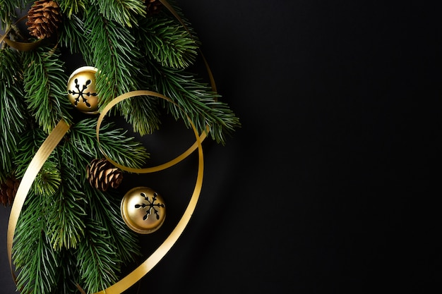 Christmas deco with fir and baubles on dark background. flat lay. christmas concept