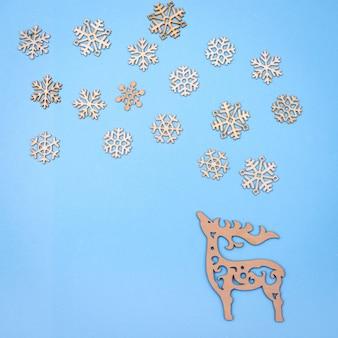 Christmas decor background - wooden raindeer enjoying snowfall