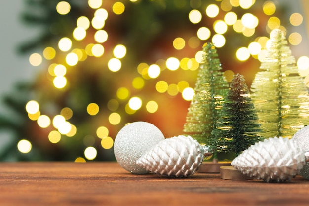 Christmas decor balls on wooden plank, copy space