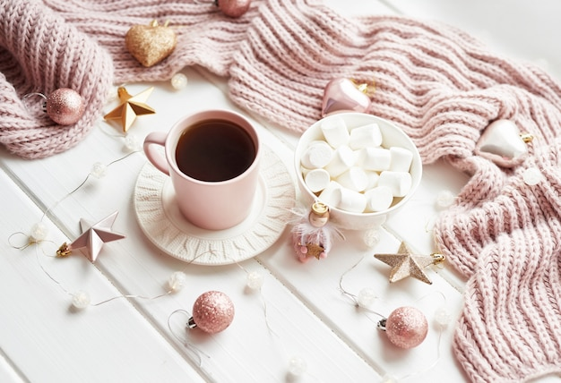 Christmas decor, balls, woolen plaid on the window , home comfort concept, seasonal winter celebrations. . christmas pink cup with marshmallow.