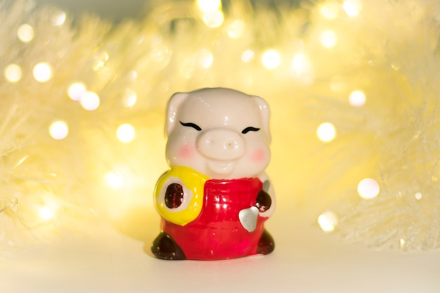 Christmas decor. ceramic pig, symbol of the new year 2019 on chinese calendar bokeh background
