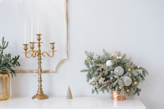 Christmas decor in a classic living room or bedroom in bright colors spruce branches