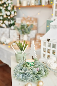 Christmas decor in kitchen. christmas tableware. christmas cooking utensils. bright interior of new year's cuisine. new year card template. white mint colors kitchen.