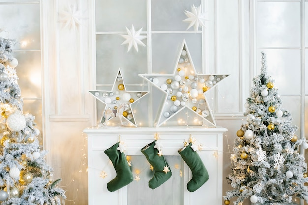 Christmas decor of the white fireplace in the living room