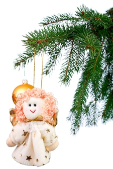 Christmas decoration - the angel on the christmas tree on a white background