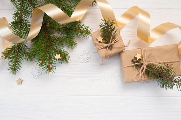 Christmas decoration,, beige bow, gold gift box and cone