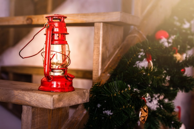Christmas decoration card with vintage christmas toys tree branches kerosene oil lamp