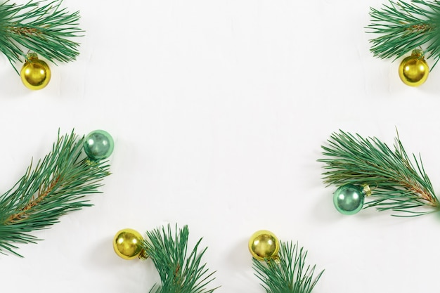 Christmas decoration. christmas tree with new year's glass ball. frame of pine branches. flat lay, top view, background