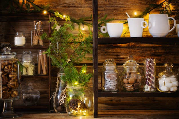 Christmas decoration cocoa bar with cookies and sweets on old wooden background in  natural rustic style