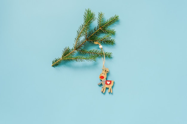 Christmas decoration deer toy on fir branch. concept merry christmas or happy new year