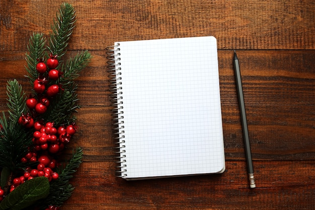 Christmas decoration and empty notebook for writing goals