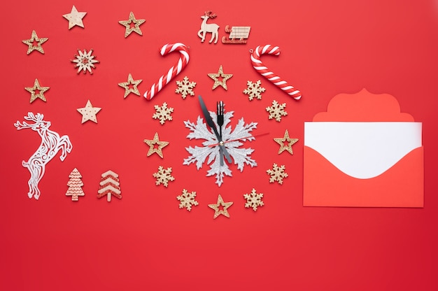Christmas decoration in the form of a clock on a red background and there is also free space for text