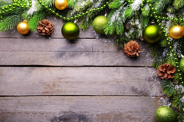 Christmas decoration frame on wooden background