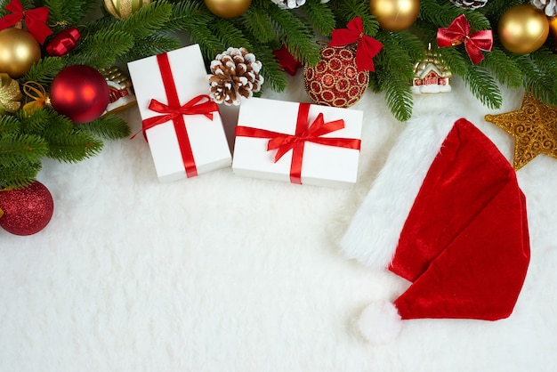 Christmas decoration and gift boxes on fir tree branch