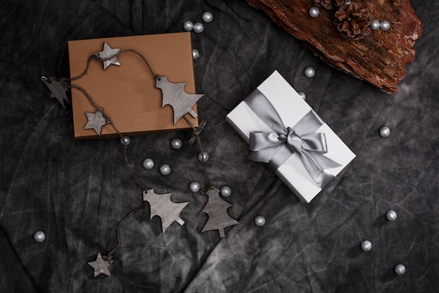 Christmas decoration and gift boxes over grey background. above.