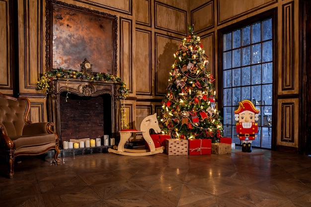 Christmas decoration in grunge room interior with fireplace, horse rocking kids chair, classic tree with presents