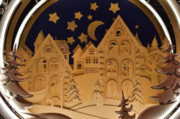 Новогоднее украшение в москве, украшение в виде сказочных домиков, игрушечных домиков.