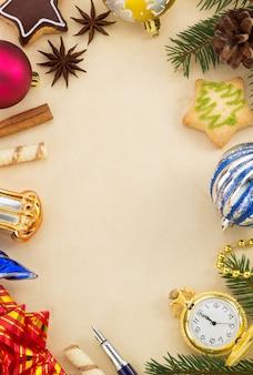 紙の背景にクリスマスの装飾