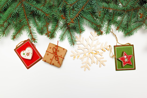 Christmas decoration pine branches gifts flat lay