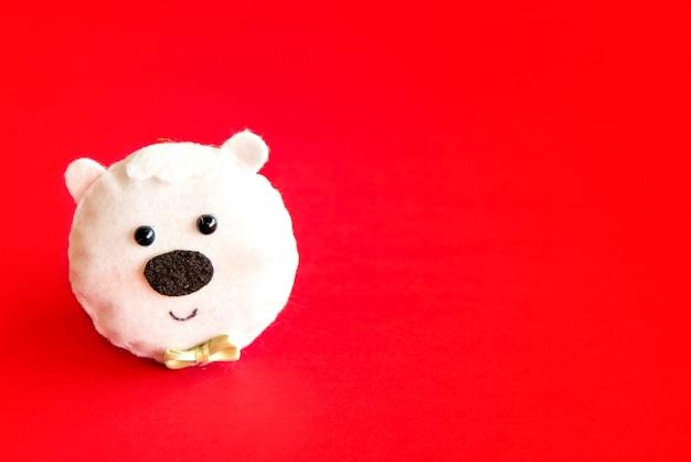 Christmas decoration. polar bear dummy on red background.