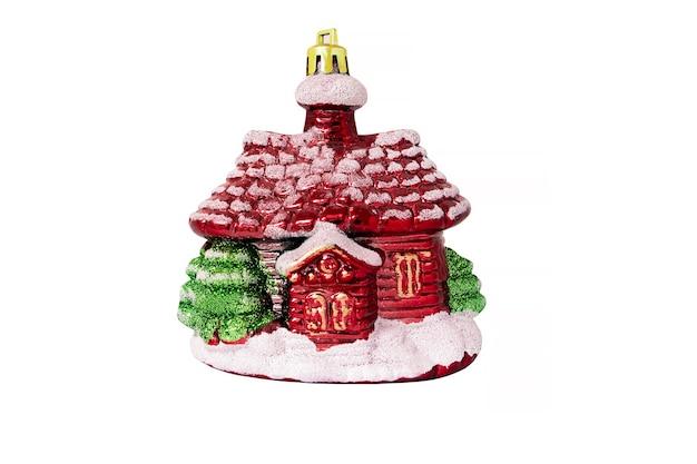 白い背景で隔離のクリスマスの装飾赤い家