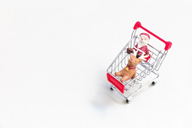 Christmas decoration on red shopping cart.