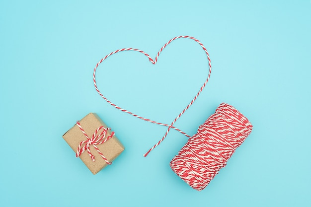 Christmas decoration red and white twine in shape of heart and gift box. concept christmas gift