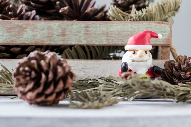 Christmas decoration of santa claus and pine cones