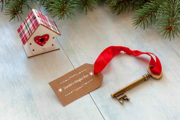 Christmas decoration - santa's magic key. close-up on light blue wooden background