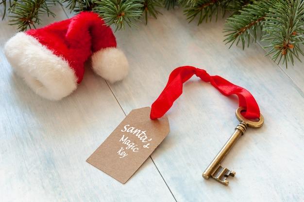 Christmas decoration - santa's magic key and santaã¢â€â™s hat. close-up on light blue back