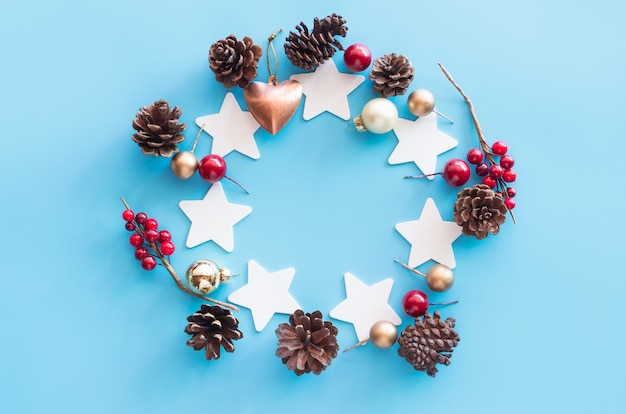 Christmas decoration set place on blue table from top view