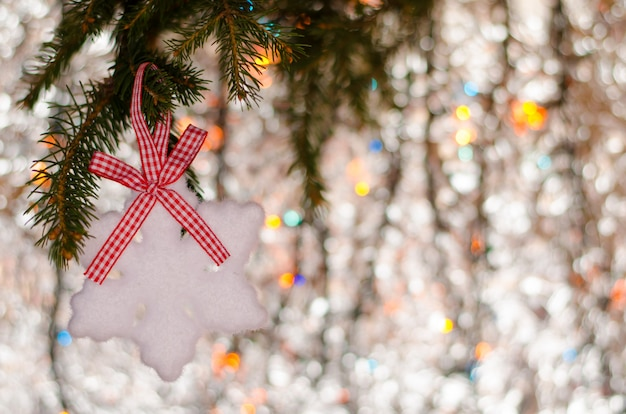 Christmas decoration snowflake element and branch of spruce on sparkling . copyspace.